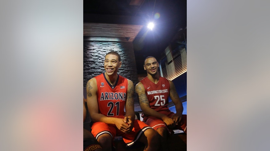 Arizona forward Brandon Ashley, left, and Washington State guard DaVonte Lacy smile during NCAA college basketball Pac-12 media day in San Francisco, Thursday, Oct. 23, 2014. (AP Photo/Jeff Chiu)