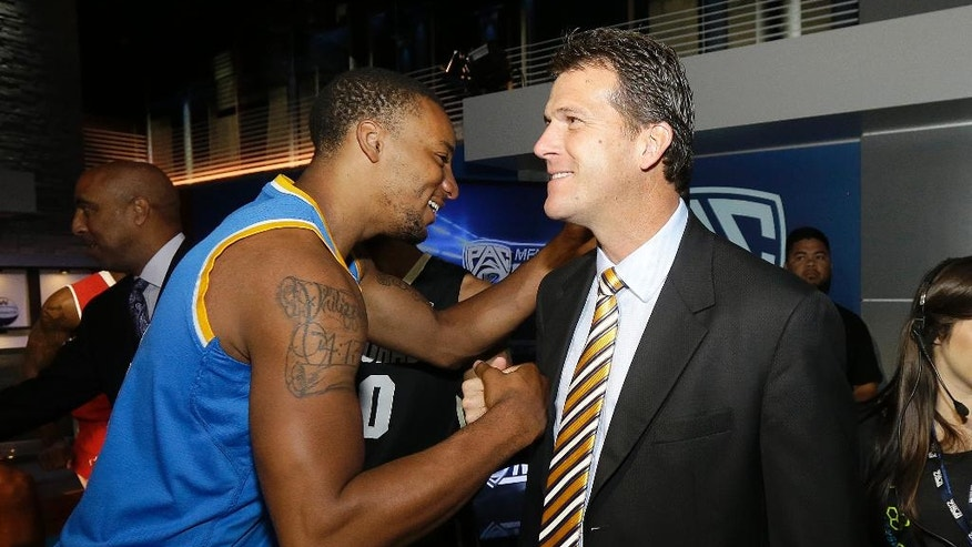 UCLA guard Norman Powell, left, greets head coach Steve Alford during NCAA college basketball Pac-12 media day in San Francisco, Thursday, Oct. 23, 2014. (AP Photo/Jeff Chiu)