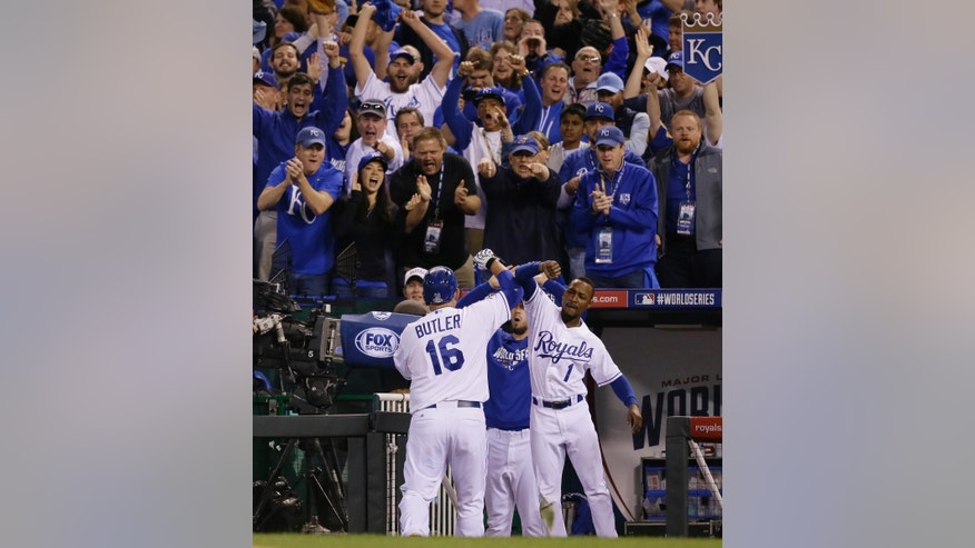 Kansas City Royals Billy Butler (16) is congratulated by his teammate Jarrod Dyson after Butler's RBI single during the sixth inning of Game 2 of baseball's World Series against the San Francisco Giants Wednesday, Oct. 22, 2014, in Kansas City, Mo. (AP Photo/Charlie Neibergall)