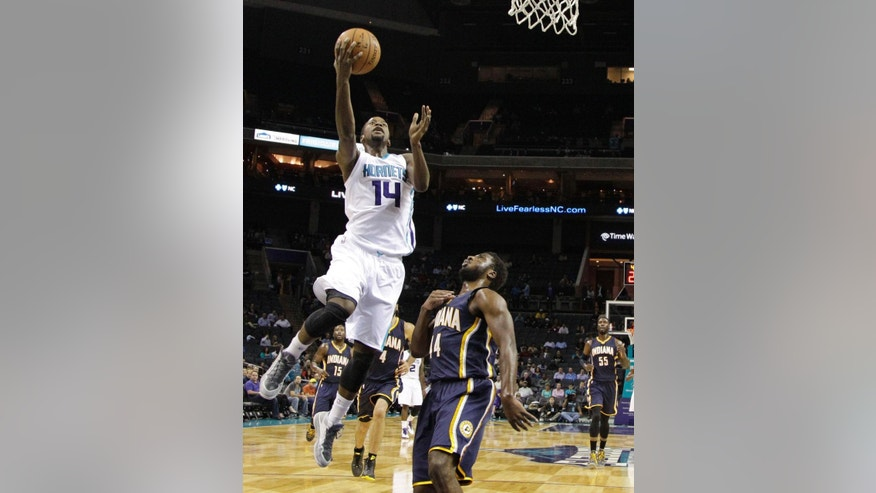 Charlotte Hornets' Michael Kidd-Gilchrist (14) drives past Indiana Pacers' Solomon Hill (44) during the first half of a preseason NBA basketball game in Charlotte, N.C., Thursday, Oct. 23, 2014. (AP Photo/Chuck Burton)
