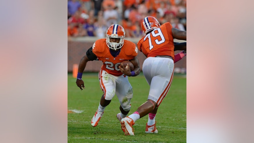 FILE - In this Oct. 11, 2014, file photo, Clemson running back Adam Choice runs out of the backfield with blocking help from Isaiah Battle during an NCAA college football game against Louisville in Clemson, S.C. Clemson coach Dabo Swinney said leading running back Adam Choice is lost for the season after tearing a knee ligament. (AP Photo/ Richard Shiro, File)