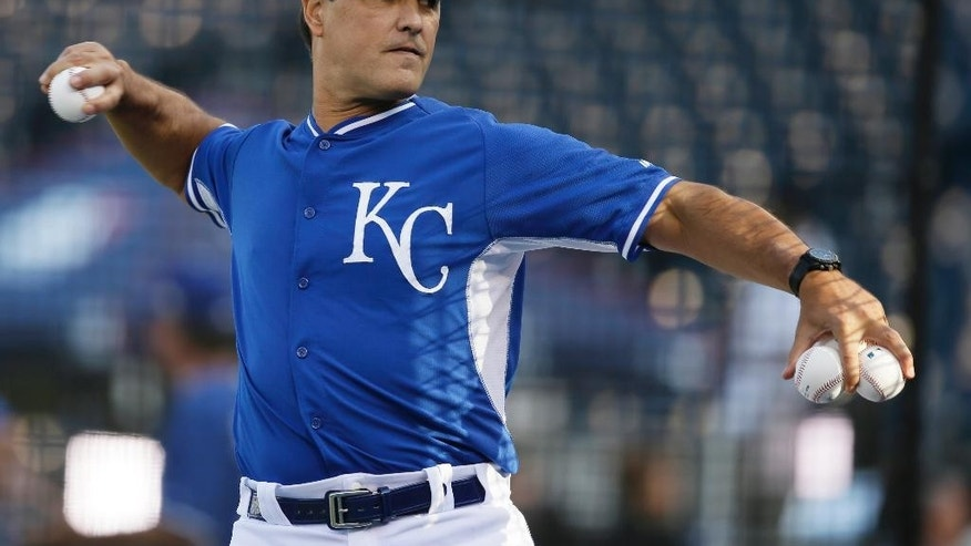 Kansas City Royals bench coach Don Wakamatsu pitches to batters during the team's warm up before Game 2 of baseball's World Series against the San Francisco GiantsWednesday, Oct. 22, 2014, in Kansas City, Mo. (AP Photo/Charlie Neibergall)