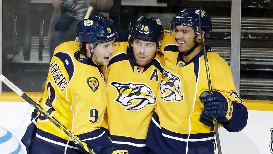 Nashville Predators left wing James Neal (18) celebrates with Filip Forsberg (9), of Sweden, and Seth Jones (3) after scoring a goal against the Chicago Blackhawks in the first period of an NHL hockey game Thursday, Oct. 23, 2014, in Nashville, Tenn. (AP Photo/Mark Humphrey)