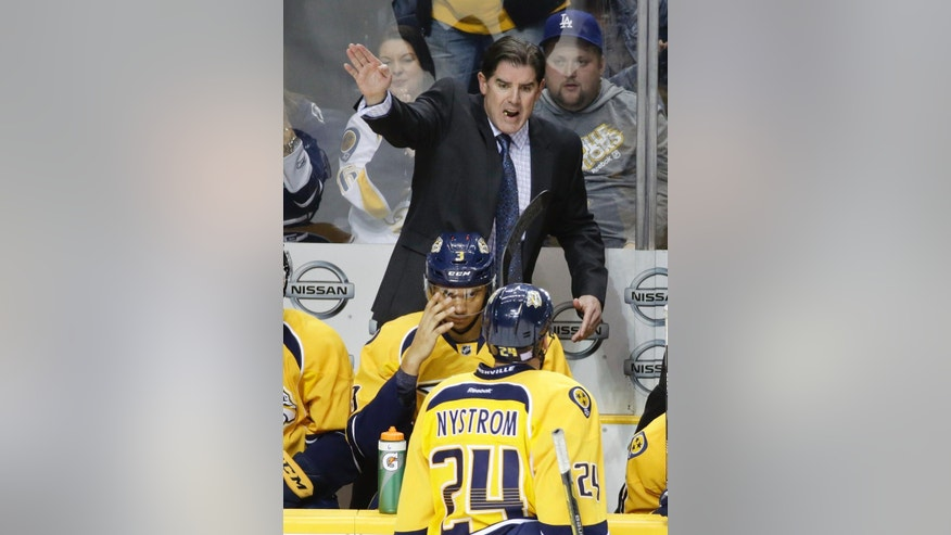 Nashville Predators head coach Peter Laviolette directs his team in the second period of an NHL hockey game against the Chicago Blackhawks, Thursday, Oct. 23, 2014, in Nashville, Tenn. (AP Photo/Mark Humphrey)