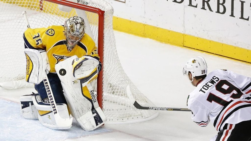 Nashville Predators goalie Pekka Rinne (35), of Finland, blocks a shot by Chicago Blackhawks center Jonathan Toews (19) in the second period of an NHL hockey game Thursday, Oct. 23, 2014, in Nashville, Tenn. (AP Photo/Mark Humphrey)