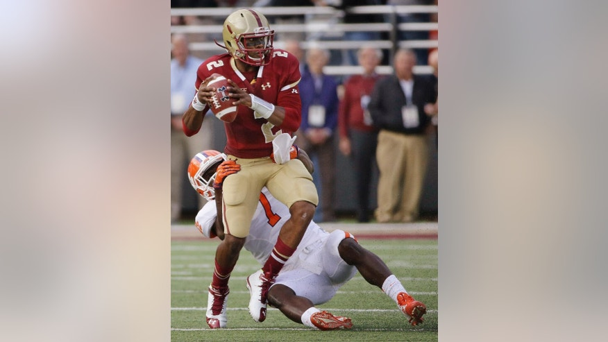 Boston College quarterback Tyler Murphy (2) is sacked by Clemson linebacker Tony Steward (7) during the first quarter of an NCAA college football game, Saturday, Oct. 18, 2014, in Boston. (AP Photo/Stephan Savoia)