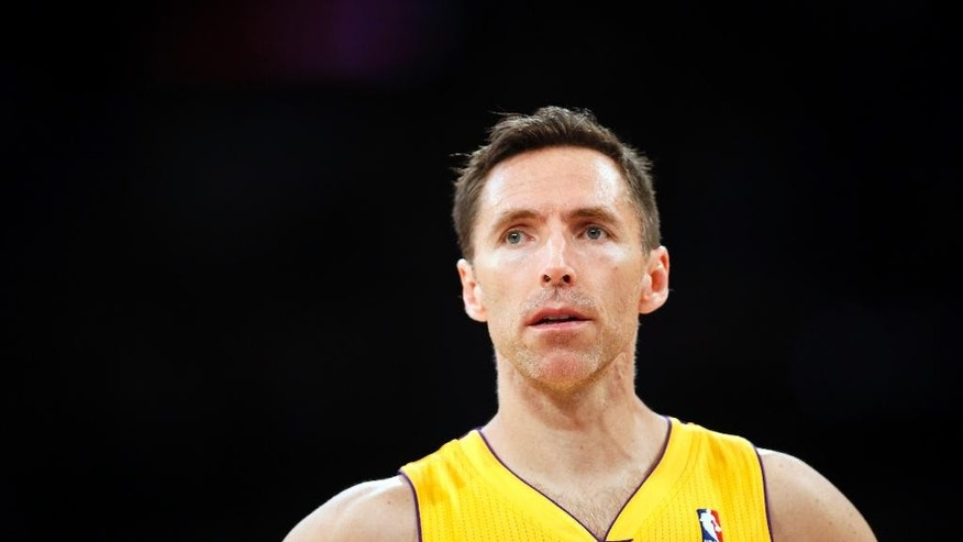 FILE - In this April 1, 2014, file photo, Los Angeles Lakers guard Steve Nash stands on the court during the first half of an NBA basketball game against the Portland Trail Blazers in Los Angeles. The Lakers announced Thursday, Oct. 23, 2014, that Nash has been ruled out for the upcoming season with a back injury, putting the two-time NBA MVP's career in doubt. (AP Photo/Danny Moloshok, File)