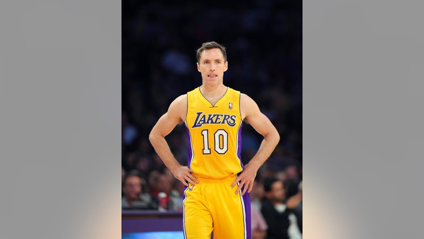 FILE - In this April 8, 2014, file photo, Los Angeles Lakers guard Steve Nash looks on during the first half of an NBA basketball game against the Houston Rockets in Los Angeles. The Lakers announced Thursday, Oct. 23, 2014, that Nash has been ruled out for the upcoming season with a back injury, putting the two-time NBA MVP's career in doubt. (AP Photo/Mark J. Terrill, File)