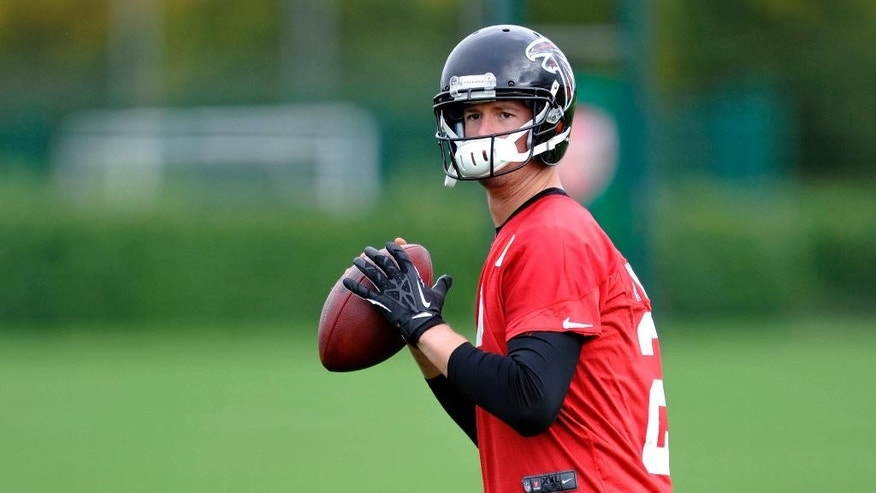 In this photo provided by the NFL, Atlanta Falcons quarterback Matt Ryan attends a team football practice session at London Colney, on the outskirts of London, Thursday, Oct. 23, 2014. The Atlanta Falcons will play the Detroit Lions in an NFL football game at London's Wembley Stadium on Sunday. (AP Photo/NFL, Sean Ryan)
