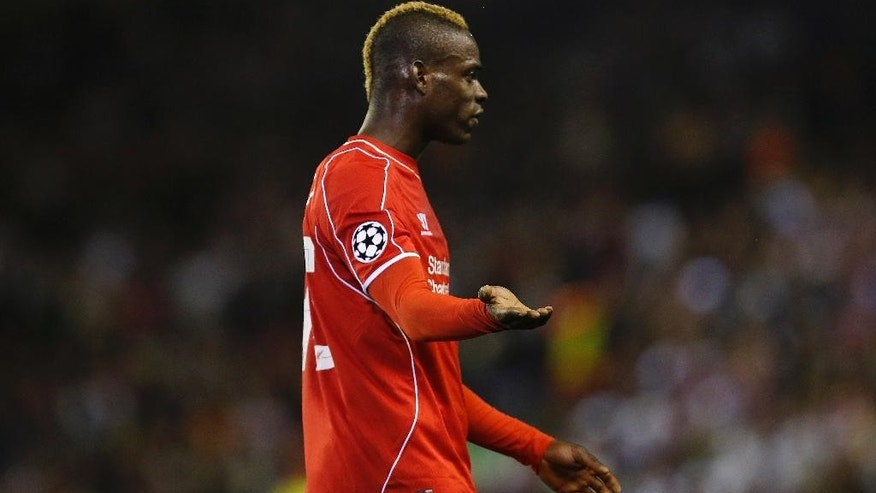 Liverpool's Mario Balotelli gestures during the Champions League group B soccer match between Liverpool and Real Madrid at Anfield Stadium, Liverpool, England, Wednesday Oct. 22, 2014. (AP Photo/Jon Super)