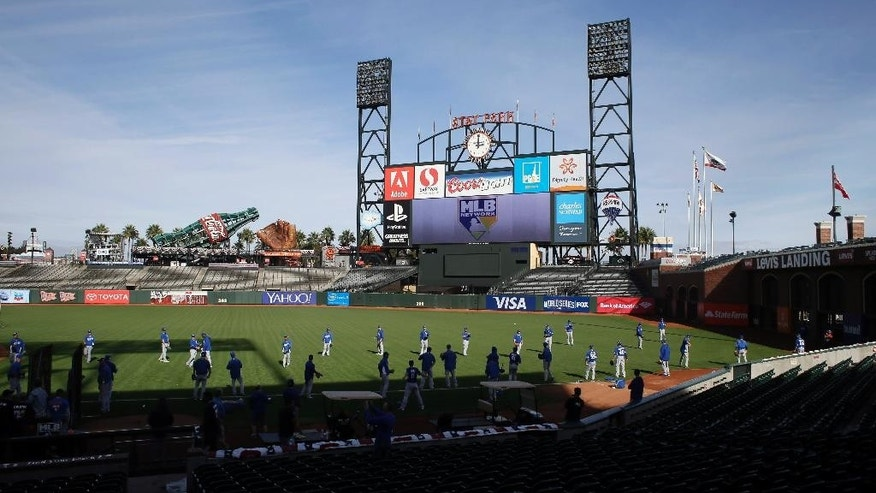The Kansas City Royals throw in the outfield during a baseball workout Thursday, Oct. 23, 2014, in San Francisco. The Royals and San Francisco Giants are scheduled to play Game 3 of the World Series in San Francisco on Friday. (AP Photo/Eric Risberg)