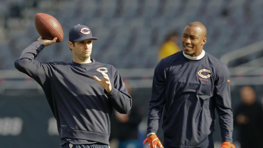 Chicago Bears quarterback Jay Cutler, left, and wide receiver Brandon Marshall warm up before an NFL football game against the Miami Dolphins Sunday, Oct. 19, 2014 in Chicago, (AP Photo/Nam Y. Huh)