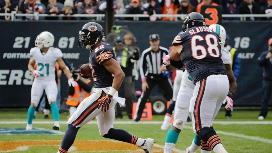 Chicago Bears running back Matt Forte (22) runs into the end zone for a touchdown during the second half of an NFL football game against the Miami Dolphins Sunday, Oct. 19, 2014 in Chicago. (AP Photo/Charles Rex Arbogast)