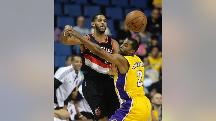 Portland Trail Blazers' Allen Crabbe, left, passes the ball as he is defended by Los Angeles Lakers' Wayne Ellington during the first half of a preseason NBA basketball game Wednesday, Oct. 22, 2014, in Ontario, Calif. (AP Photo/Jae C. Hong)
