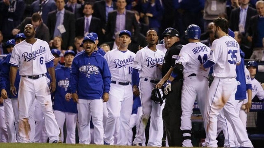 October 22, 2014: Kansas City Royals yell at San Francisco Giants pitcher Hunter Strickland after an exchange with Salvador Perez during the sixth inning of Game 2 of baseball's World Series. (AP Photo/Charlie Neibergall)