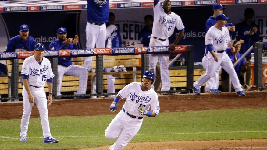 Kansas City Royals' Salvador Perez rounds first after hitting a two-run scoring double during the sixth inning of Game 2 of baseball's World Series against the San Francisco Giants Wednesday, Oct. 22, 2014, in Kansas City, Mo. (AP Photo/Charlie Riedel)