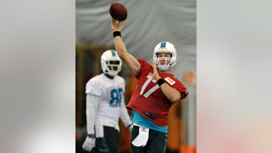 Miami Dolphins quarterback Ryan Tannehill (17) passes during an NFL football practice in Davie, Fla., Tuesday, Oct. 21, 2014. (AP Photo/Alan Diaz)