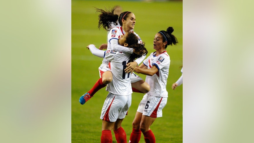 Costa Rica's Raquel Rodríguez Cedeno (11) celebrates her goal with Katherine Alvarado, top left, and Carol Sanchez (6) during the second half of a CONCACAF soccer match against Martinique, at RFK Stadium, Tuesday, Oct. 21, 2014, in Washington. Costa Rica's won 6-1. (AP Photo/Nick Wass)