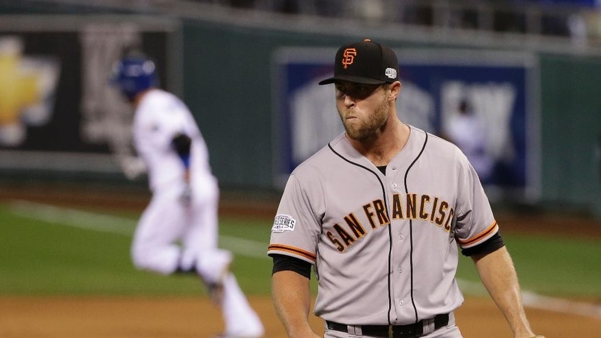 San Francisco Giants pitcher Hunter Strickland watches as Kansas City Royals Omar Infante runs around the bases after hitting a two-run home run during the sixth inning of Game 2 of baseball's World Series Wednesday, Oct. 22, 2014, in Kansas City, Mo. (AP Photo/Matt Slocum)