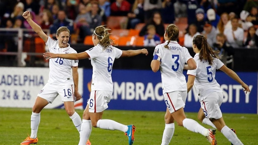 FILE - In this Oct. 20, 2014, file photo, United States defender Meghan Klingenberg (16) celebrates her goal with defenders Whitney Engen (6), Christie Rampone (3) and Kelley O´Hara (5) during the second half of a CONCACAF soccer match against Haiti, at RFK Stadiumin Washington. The Women's World Cup kicks off in Canada in June 2015 _ and if the favored U.S. squad advances far, expect some more massive TV audiences. (AP Photo/Alex Brandon, File)