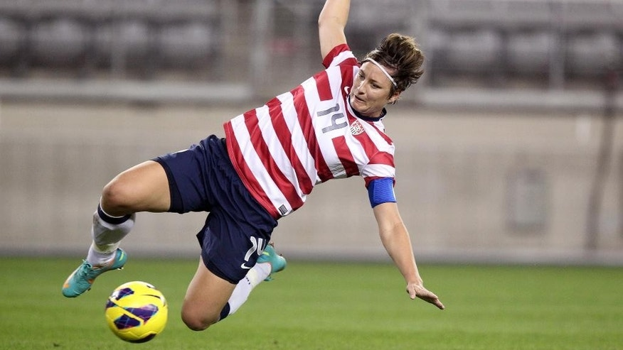 FILE - This Dec. 1, 2012, file photo shows United States' Abby Wambach in an international friendly soccer match against Ireland in Glendale, Ariz. A year after the World Cup transformed millions of Americans into red-white-and-blue-wearing soccer fanatics, another chance to cheer for a national team will arrive. Not just in group-stage matches, but very possibly for a championship. The Women's World Cup kicks off in Canada in June 2015 _ and if the favored U.S. squad advances far, expect some more massive TV audiences. (AP Photo/Paul Connors, File)