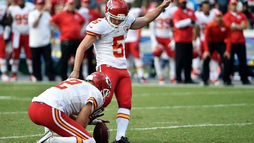 Kansas City Chiefs kicker Cairo Santos kicks the game-winning field goal against the San Diego Chargers during the second half of an NFL football game Sunday, Oct. 19, 2014, in San Diego. (AP Photo/Denis Poroy)