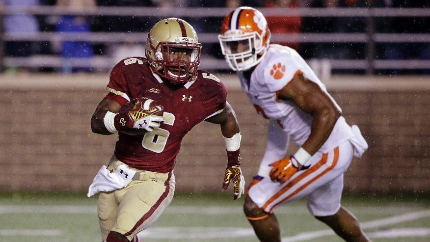 Boston College wide receiver Sherman Alston (6) gets by Clemson defensive end Vic Beasley (3) on a reverse during the fourth quarter of an NCAA college football game Saturday, Oct. 18, 2014, in Boston. Clemson defeated Boston College 17-13. (AP Photo/Stephan Savoia)