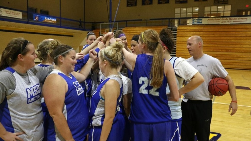 Lauren Hill (22) finishes practice with her NCAA college basketball team at Mount St. Joseph in Cincinnati on Thursday, Oct. 23, 2014. She's turning those last few months into a celebration of life and a chance to support a cause. (AP Photo/Tom Uhlman)