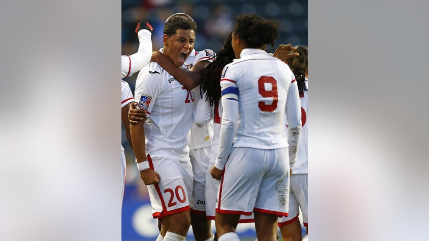 Trinidad and Tobago defender Lauren Hutchinson (20) reacts after her tying goal against Costa Rica in the second half during a CONCACAF semifinal soccer match in Philadelphia, Pa., Friday, Oct. 24, 2014. (AP Photo/Rich Schultz)