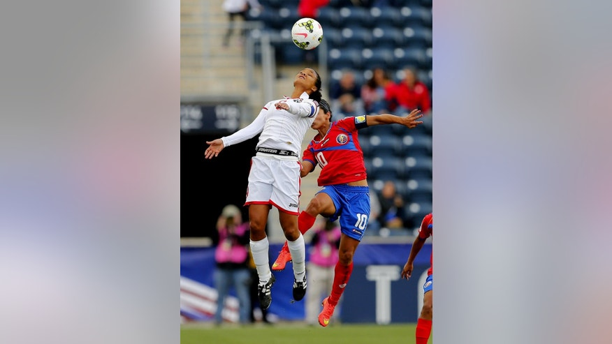 Trinidad and Tobago midfielder Khadidra Debessete, left, heads the ball away from Costa Rica midfielder Shirley Cruz (10) in the first half during a CONCACAF semifinal soccer match in Philadelphia, Pa., Friday, Oct. 24, 2014. (AP Photo/Rich Schultz)