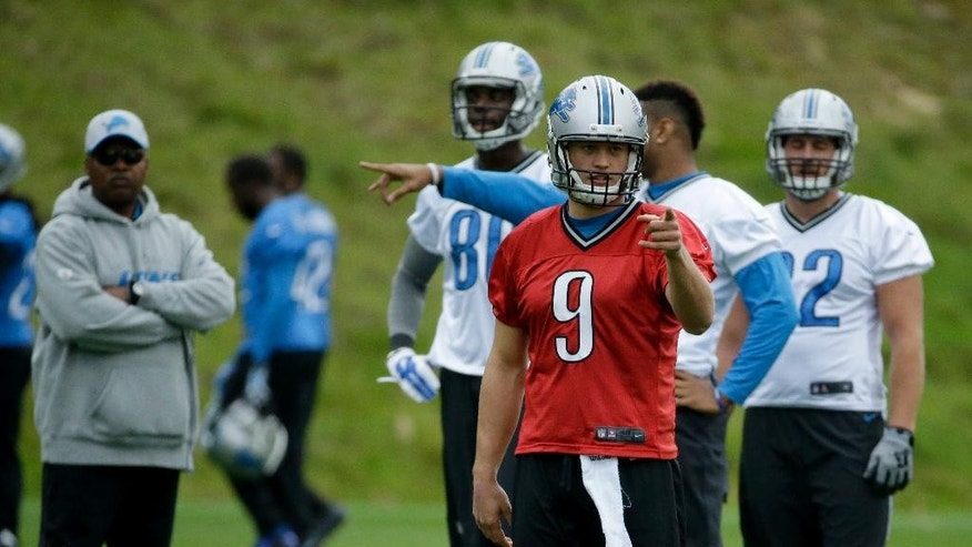 Detroit Lions quarterback Matthew Stafford, 9, points during a training session at Pennyhill Park Hotel in Bagshot, England, Thursday, Oct. 23, 2014.  The Atlanta Falcons will play the Detroit Lions in an NFL football game at London's Wembley Stadium on Sunday.  (AP Photo/Matt Dunham)