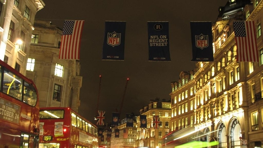 American flags and National Football League banners adorn London's Regent Street ahead of the Atlanta Falcons-Detroit Lions football game Thursday, Oct. 23, 2014. Fans are expected to rally at Trafalgar Square in the British capital a day before Sunday's showdown at Wembley, the second of three NFL games being staged at England's national stadium this year. (AP Photo/Shawn Pogatchnik)