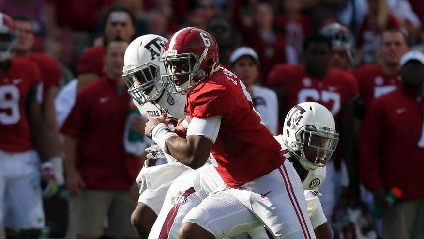 Alabama quarterback Blake Sims (6) breaks free for a long touchdown run during the first half of an NCAA college football game against Texas A&M,  Saturday, Oct. 18, 2014, in Tuscaloosa, Ala. (AP Photo/Butch Dill)