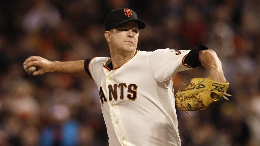 FILE - San Francisco Giants pitcher Matt Cain delivers against the Houston Astros during the sixth inning of a baseball game in San Francisco, in this June 13, 2012 file photo. Cain has been the workhorse of the San Francisco Giants' pitching staff for years, but the elbow injury ended his season and left him rooting for his teammates in the World Series. (AP Photo/Jeff Chiu, File)