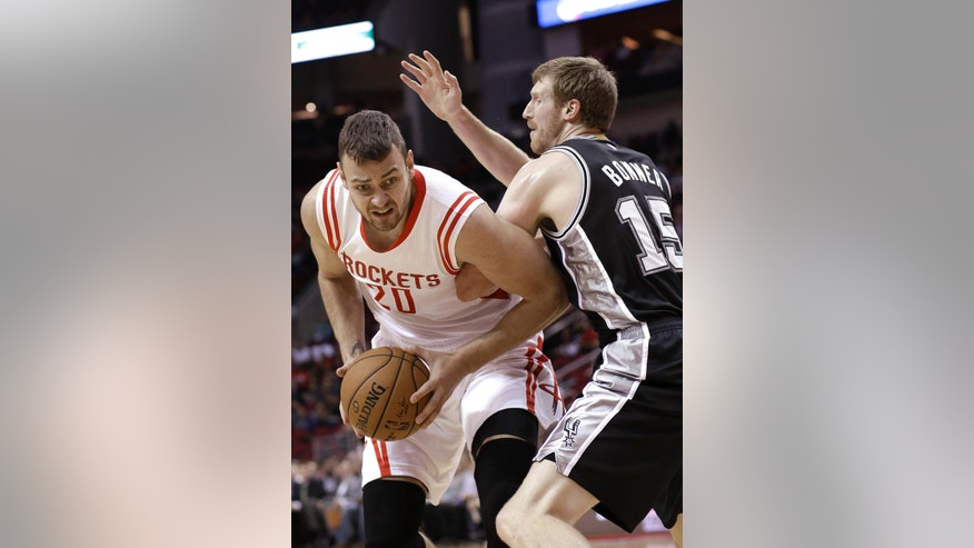 Houston Rockets' Donatas Motiejunas (20) is pressured by San Antonio Spurs' Matt Bonner (15) during the first half of an NBA exhibition basketball game Friday, Oct. 24, 2014, in Houston. (AP Photo/Pat Sullivan)
