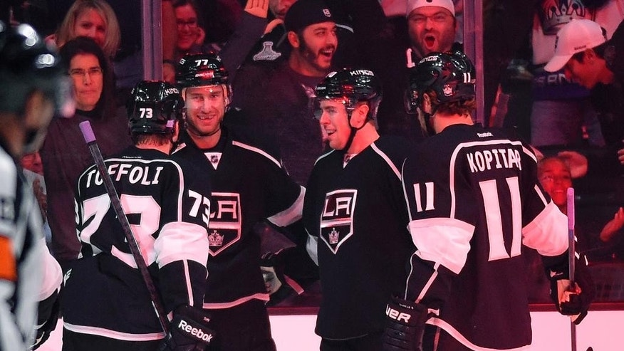 Los Angeles Kings center Jeff Carter, second from left, celebrates his goal with center Tyler Toffoli, left, left wing Tanner Pearson, second from right, and center Anze Kopitar, of Slovenia, during the first period of an NHL hockey game against the Buffalo Sabres, Thursday, Oct. 23, 2014, in Los Angeles. (AP Photo/Mark J. Terrill)