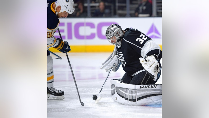 Buffalo Sabres right wing Chris Stewart, left, tries to get a shot in against Los Angeles Kings goalie Jonathan Quick during the first period of an NHL hockey game, Thursday, Oct. 23, 2014, in Los Angeles. (AP Photo/Mark J. Terrill)