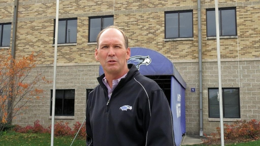 In this Oct. 21, 2014, photo, Wisconsin-Whitewater college football coach Lance Leipold answers a question outside Perkins Stadium in Whitewater, Wis. The Division III coach reached 100 career wins in 106 games, the fastest to the 100-win plateau in NCAA history. (AP Photo/Genaro C. Armas)