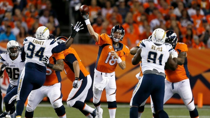 Denver Broncos quarterback Peyton Manning (18) throws during the first half against the San Diego Chargers in an NFL football game, Thursday, Oct. 23, 2014, in Denver. (AP Photo/Joe Mahoney)