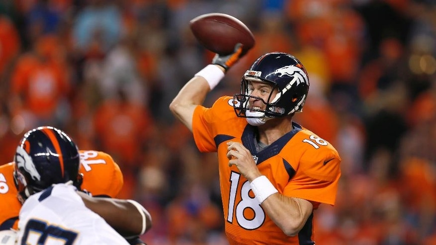 Denver Broncos quarterback Peyton Manning (18) throws against the San Diego Chargers during the first half of an NFL football game, Thursday, Oct. 23, 2014, in Denver. (AP Photo/Joe Mahoney)