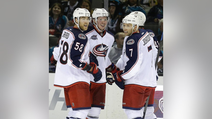 Columbus Blue Jackets' Ryan Johansen, second from left, is congratulated by David Savard (58) and Jack Johnson (7) after Johansen scored a goal against the San Jose Sharks during the second period of an NHL hockey game Thursday, Oct. 23, 2014, in San Jose, Calif. (AP Photo/Ben Margot)