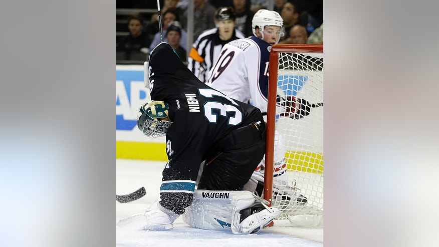 Columbus Blue Jackets' Ryan Johansen, right, scores a goal past San Jose Sharks goalie Antti Niemi (31) during the second period of an NHL hockey game Thursday, Oct. 23, 2014, in San Jose, Calif. (AP Photo/Ben Margot)