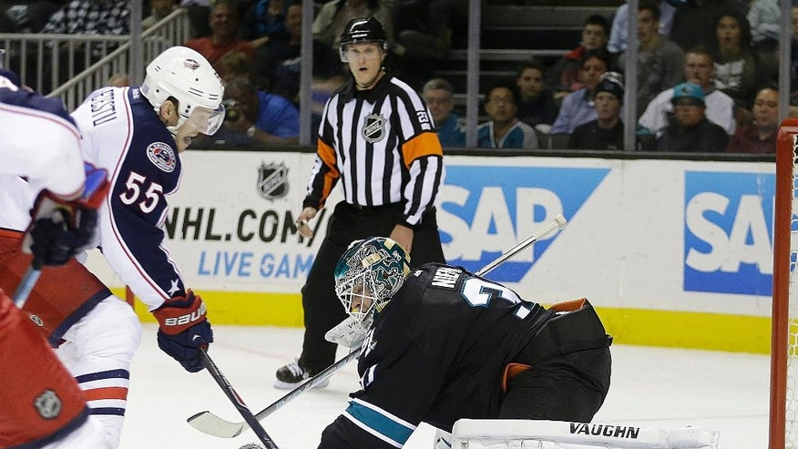 Columbus Blue Jackets' Mark Letestu (55) scores past San Jose Sharks goalie Antti Niemi during the second period of an NHL hockey game Thursday, Oct. 23, 2014, in San Jose, Calif. (AP Photo/Ben Margot)
