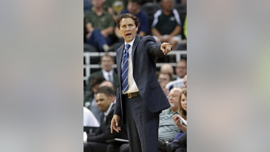 FILE - In this Oct. 7, 2014, file photo, Utah Jazz coach Quin Snyder shouts to his team during an NBA preseason basketball game against the Portland Trail Blazers in Salt Lake City. Snyder has seen life through all sorts of perspectives. He has a law degree, an MBA, has coached everywhere from Russia to the NBA D-League. And now he's an NBA head coach for the first time, tasked with getting the Jazz back to prominence in a loaded Western Conference. (AP Photo/Rick Bowmer, File)