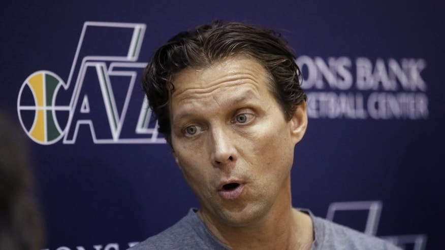 Utah Jazz coach Quin Snyder speaks with reporters following basketball practice Thursday, Oct. 23, 2014, in Salt Lake City. Snyder played and worked for Mike Krzyzewski. He's received firsthand instruction from Larry Brown, Gregg Popovich and Doug Collins. R.C. Buford, now the San Antonio general manager, once recruited Snyder to play at Kansas. At Duke, Snyder became teammates with future GMs Billy King and Danny Ferry. (AP Photo/Rick Bowmer)