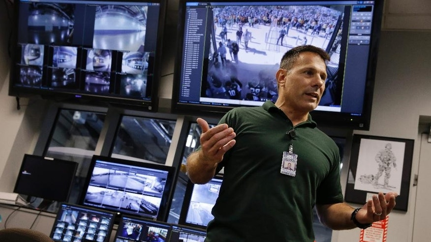 "In this Oct. 15, 2014, photo, Daniel DeLorenzi, director of security and safety services at MetLife Stadium, stands near monitors for security cameras in the command center at the stadium in East Rutherford, N.J.  ""The idea is to see every seat in the bowl,"" DeLorenzi says. The cameras installed late last year before the stadium hosted the Super Bowl feature a system that provides comprehensive, undisrupted video coverage throughout every part of the venue, except inside the luxury boxes. (AP Photo/Mel Evans)"