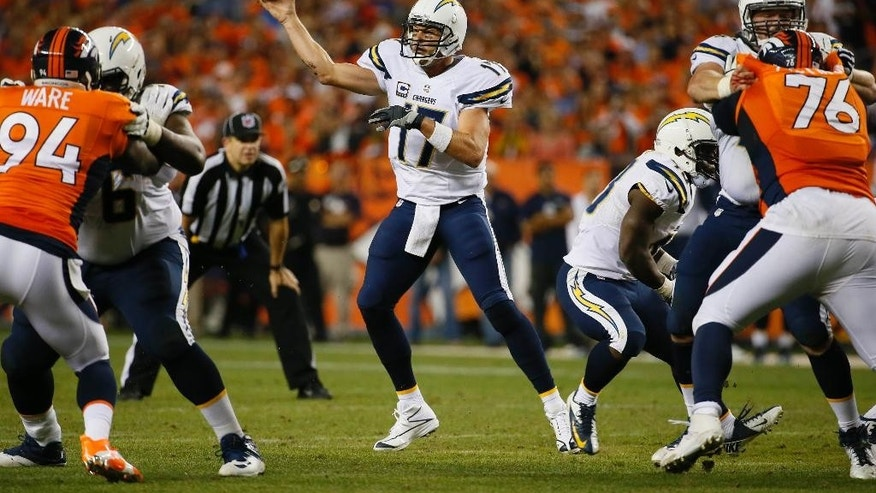 San Diego Chargers quarterback Philip Rivers throws against the Denver Broncos during the first half of an NFL football game, Thursday, Oct. 23, 2014, in Denver. (AP Photo/Jack Dempsey)