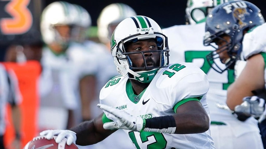 Marshall quarterback Rakeem Cato prepares to pass against Florida International during the first half of an NCAA college football game, Saturday, Oct. 18, 2014, in Miami. (AP Photo/Alan Diaz)