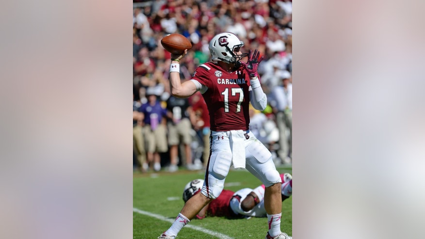 South Carolina quarterback Dylan Thompson drops back and delivers a pass during the second half of an NCAA college football game against Furman in Columbia, S.C.,  Saturday, Oct. 18, 2014. South Carolina won 41-10. (AP Photo/ Richard Shiro)