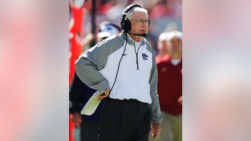 Kansas State head coach Bill Snyder watches from the sidelines during the second quarter of an NCAA college football game against Oklahoma in Norman, Okla., Saturday, Oct. 18, 2014. Kansas State won 31-30. (AP Photo/Sue Ogrocki)